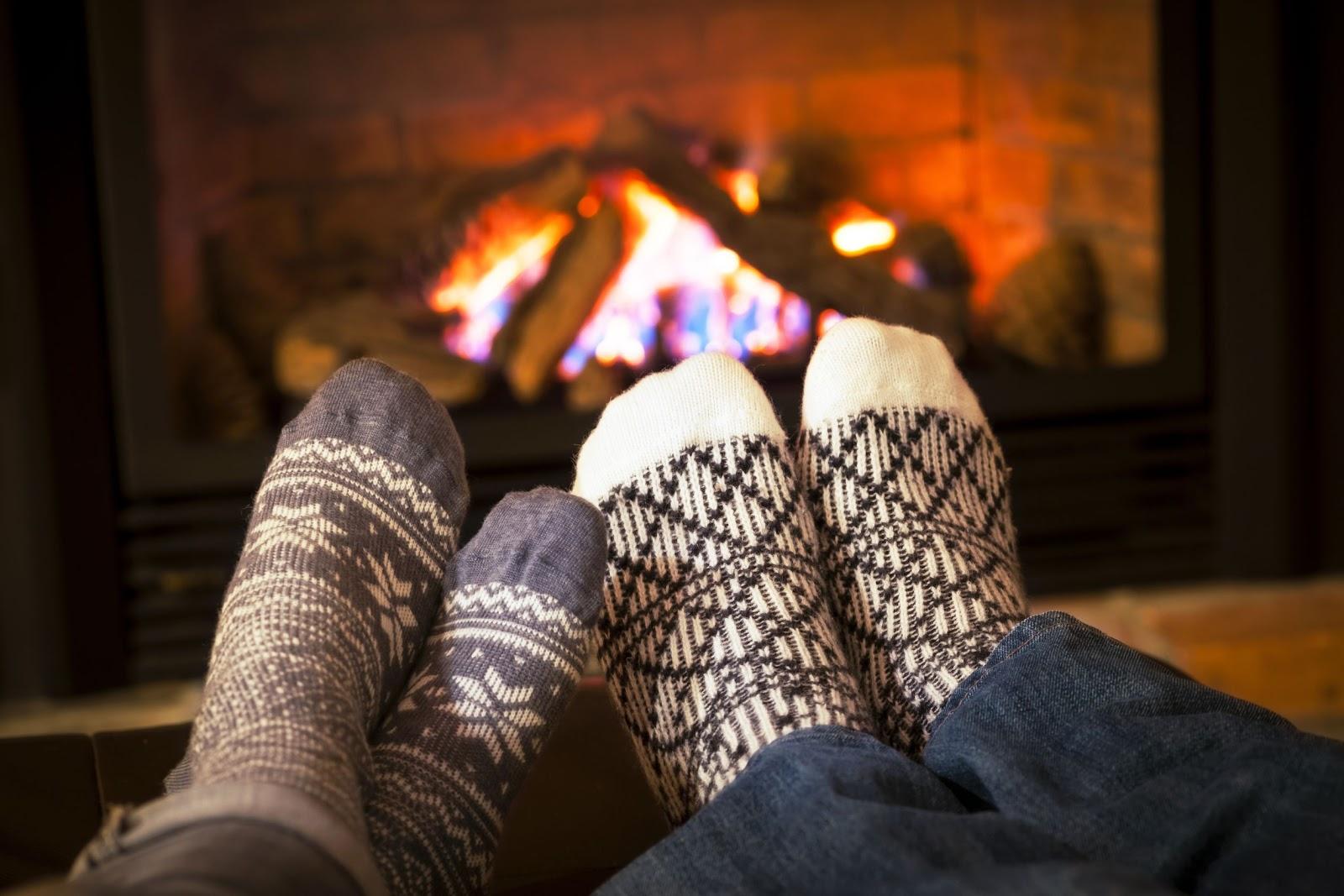 Feet In Socks Warming By Cozy Fire